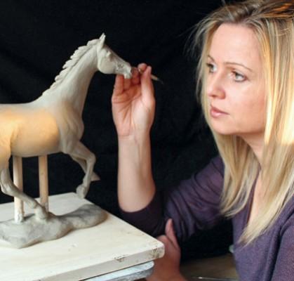 Amanda Hughes-Lubeck sculpting a horse