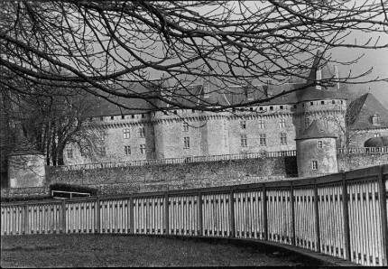 France Castle and Fence, Looking up to the castle of Pompadour from the racetrack, Races are run below the Chateau de Pompadour in the Limousin, France, home of one of 24 national stud farms.
