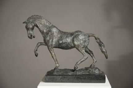 """""""Cavalla Caracollante"""" (Prancing Mare), Bronze on cambrian black granite, 11 x 14.75 x 4.5 inches"""
