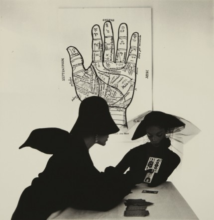 "Irving Penn ""The Tarot Reader"" (Bridget Tichenor and Jean Patchett) New York, 1949, Selenium toned gelatin silver print, printed 1984, 18.5 x 19 inches (47 x 48.3 cm) Signed, titled, dated in ink and Condé Nast copyright credit reproduction limitation stamp on the verso. One from an edition of 26."