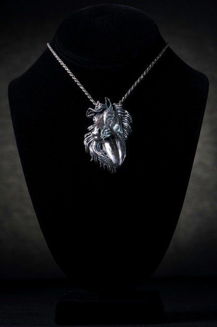 Horse Head Pendant — The sterling silver pendant boldly states the intricate features of a horse's head that is brilliantly accented with diamonds set within the eyes of this carefully crafted and stylishly presented piece of art.