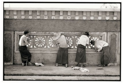 """Cleaning the wheels of Dharma on a fence"" Gelatin silver print, Edition of 25, Paper size: 50 x 60 cms, Also available in 40 x 50 cms & 76 x 100 cms"