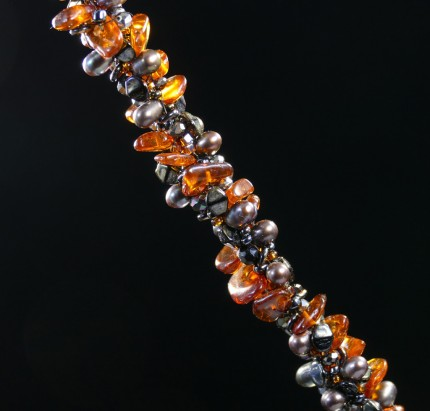 "Irene Greenberg ""Ambling Along Silver & Beadwork Necklace"" Pendant: 1.5"" square, Overall length: 18"", Price: $650, Chisholm Ref #: SBW-N1 - This one-of-a-kind, beaded necklace is made of amber, freshwater pearls, fire polished Czech crystals, and Japanese square & ring shaped glass beads. The handmade silver bead caps show the imprint of many warmblood breed logos. The focal piece is a hand-painted, fused glass pendant featuring a relaxed rider ambling along."
