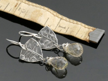 """Citrine Drop Earrings"" Overall Lemgth: 1.5"", Price: $189, Chisholm Ref. #: SE7 - Faceted citrines hang from pieces of silver textured with wildflower seed pods. Earrings are hand crafted in .960 silver. Ear wires are sterling silver (.925)."