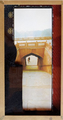 Framing the Other ii, 1998-2008, Silk Route Series, Pigment print of a panoramic photograph on watercolor paper mounted on contemporary Indian silk and European synthetic fabric covered by the a section of a Shanghai Tang Jacket in an architectural bronze frame, 11x 5 in.