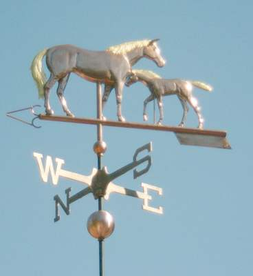 """Mare and Foal Horse Weathervane"" This is our original mare and foal weather vane design.  Examples of this weathervane can be found in British Colombia, Lexington Kentucky, as well as throughout the western United States.  In the example shown above, both horses show optional gold-leafed manes and tails.  Palladium, which is a silver colored leaf, can also be used to mimic grey markings.  If you are interested in a portrait version of this design, please feel free to send us photos and we will be happy to work up a quote for you."