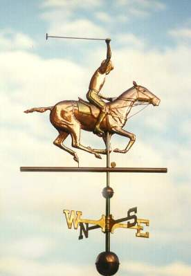 """Polo Horse with Rider"" One of our most popular horse weathervane designs, this Polo Player weather vane design can be found as far away as Perth, Australia and Bogota, Colombia, as well as in many locations across the United States. Optional gold leaf works very well with this weathervane, helping to set off many of the intricate details such as the tail wrappings, saddle blanket, leg wraps, and reins. One customer who is himself a polo player, also ordered one of our jumping horse weathervanes with a female rider for his second cupola as his wife is also an accomplished equestrian. That way both their passions are represented on their new barn."