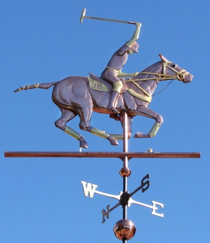 """Polo Horse with Rider Weathervane"" One of our most popular horse weathervane designs, this Polo Player weather vane design can be found as far away as Perth, Australia and Bogota, Colombia, as well as in many locations across the United States. Optional gold leaf works very well with this weathervane, helping to set off many of the intricate details such as the tail wrappings, saddle blanket, leg wraps, and reins. One customer who is himself a polo player, also ordered one of our jumping horse weathervanes with a female rider for his second cupola as his wife is also an accomplished equestrian. That way both their passions are represented on their new barn."