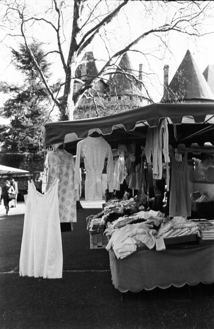 France market dresses, Market day at Pompadour, the LImousin, France, Castle of Pompadour in background. Pompadour is the site of one of 24 national stud farms of France. Extensive image collection available.