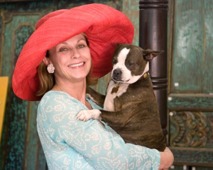 Gallery Owner Jeanne Chisholm, holds Sir Winston (Frederick Churchill) Chisholm, a Palm Beach County rescued dog she describes as 'ambassador-at-large' for Chisholm Gallery.