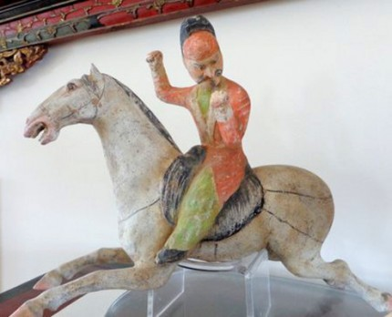 """This set of two polo players is from the Tang Dynasty, c. 618-907 AD. The players each measure about 8 ½"""" high, and the horses are about 12"""" long. There is original polychrome remaining and they are both in excellent condition. They come with Thermoluminescence Reports from Oxford dated in 2002."""
