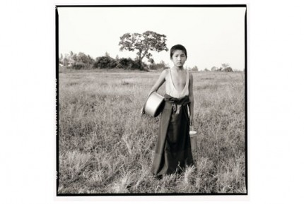 """""""Young Rato monk delivering milk"""" Gelatin silver print, Edition of 25, Paper size: 50 x 60 cms, Also available in 40 x 50 cms & 76 x 100 cms"""