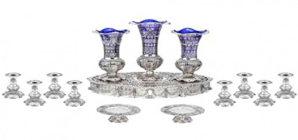 Ornate 14-piece table garniture in sterling silver