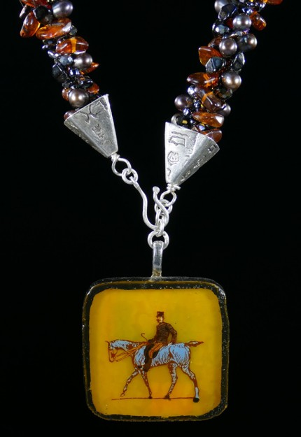 """Ambling Along Silver & Beadwork Necklace"" Pendant: 1.5"" square, Overall length: 18"", Price: $650, Chisholm Ref #: SBW-N1 - This one-of-a-kind, beaded necklace is made of amber, freshwater pearls, fire polished Czech crystals, and Japanese square & ring shaped glass beads. The handmade silver bead caps show the imprint of many warmblood breed logos. The focal piece is a hand-painted, fused glass pendant featuring a relaxed rider ambling along."
