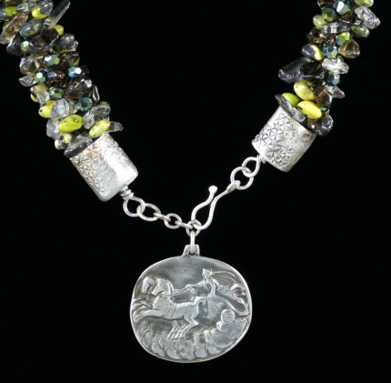 """Jade Chariot Beadwork & Silver Necklace"" Pendant: 1.25"" x 1.125"", Overall length: 22"", Price: $650, Chisholm Ref. #: SBW-N5 - This one-of-a-kind silver and beadwork necklace is made of yellow jade, smokey quartz, and Czech fire-polished crystals. The handmade end caps are lightly textured, and the focal pendant is a stunning classical charriot made in .960 silver."