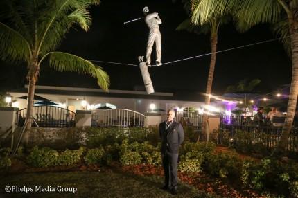 "Stanislaw Rey standing below ""The Golfer"" Photo credit: Lenore Phillips / Phelps Media Group"